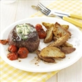 Basil-Butter Steaks with Roasted Potatoes