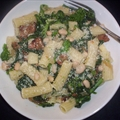 Broccoli Rabe, Spicy Italian Sausage and Beans over Pasta