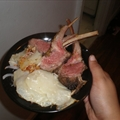 Herb-crusted Rack Of Lamb with Red Onions and Potatoes Au Gratin