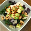 Kale salad with Parmesan, avocado, cannelini beans and pine nuts