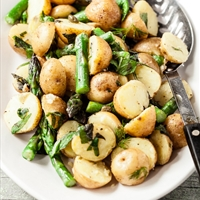 Baby potatoes with asparagus and caper dressing