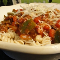 BRATS in Red Sauce over Pasta
