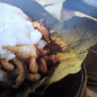 Chicken Steamed With Rice In Lotus Leaves
