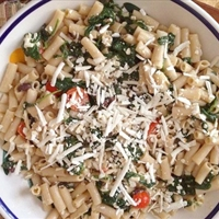 Gluten-Free Pasta with Ricotta Salata, Garlicky Spinach, Tomatoes, and Oliv