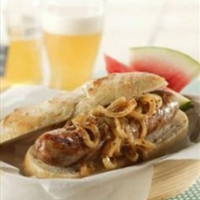 Grilled Bratwurst with Onions Braised in Beer and Mustard