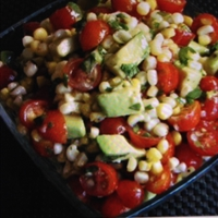 Grilled corn, avocado and tomato with honey dressing