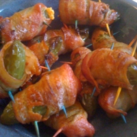 Jalapenos stuffed w/ crab and smoked cheddar, wrapped in bacon