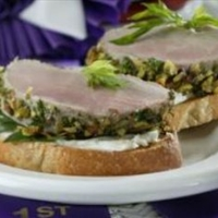 Pistachio-Crusted Pork Tenderloin Bruschetta