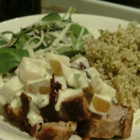Pork tenderloin with creamy pear and spring onions sauce