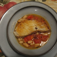 Sea Bass with white beans in tomato-rosemary broth