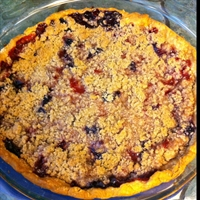 Strawberry and blueberry pie with crumble topping