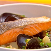 Sweet and sour salmon with mussels and clams