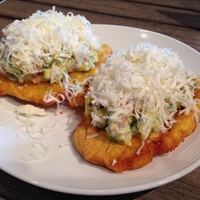 Tostones, avocado salsa, queso fresco