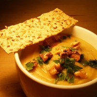 White Bean Cauliflower Soup topped with roasted walnuts and fresh parsley