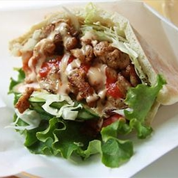 "Beef, Ham and Chicken ""Tripleta"" In Pita Bread"