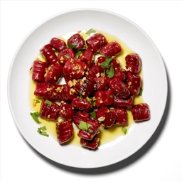Beetroot gnocchi with butter, sage and orange sauce.