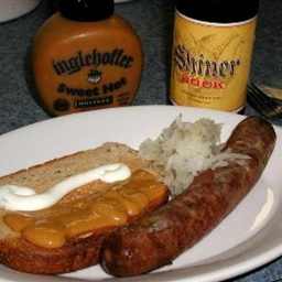 Brats Braised with Beer and Onions