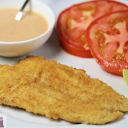 Breaded fish fillets with tomato-chipotle mayonnaise (Pescado empanizado co
