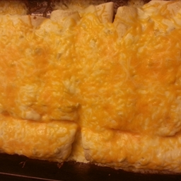 Chicken & Cheese Enchiladas with Green Chili & Sour Cream Sauce
