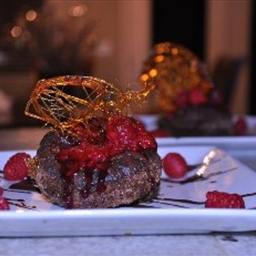 Collapsed Chocolate Souffle topped with raspberry sauce
