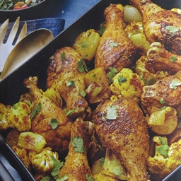Curry roasted drumsticks with cauliflower and potatoes