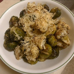 Oven Roasted Brussel Sprouts And Cauliflower Drizzled With Parmesan Cheese