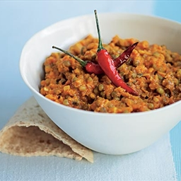 Red split lentils cooked in a pan