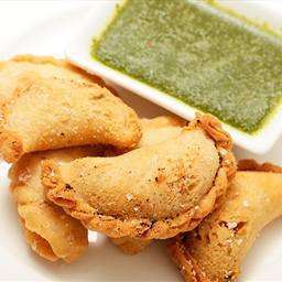 Smoky Potato and Caper Empanadas with Cilantro Sauce