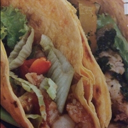 Stuffed chicken and tomatillo tacos with queso fresco