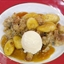 Bananas Foster Bread Pudding with Vanilla Ice Cream & Fresh Caramel Sauce