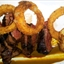 Rib-eye Steaks with Corn Meal-fried Onion Rings