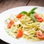 Spaghetti with Basil, Toasted Almond Pesto, and Cherry Tomatoes